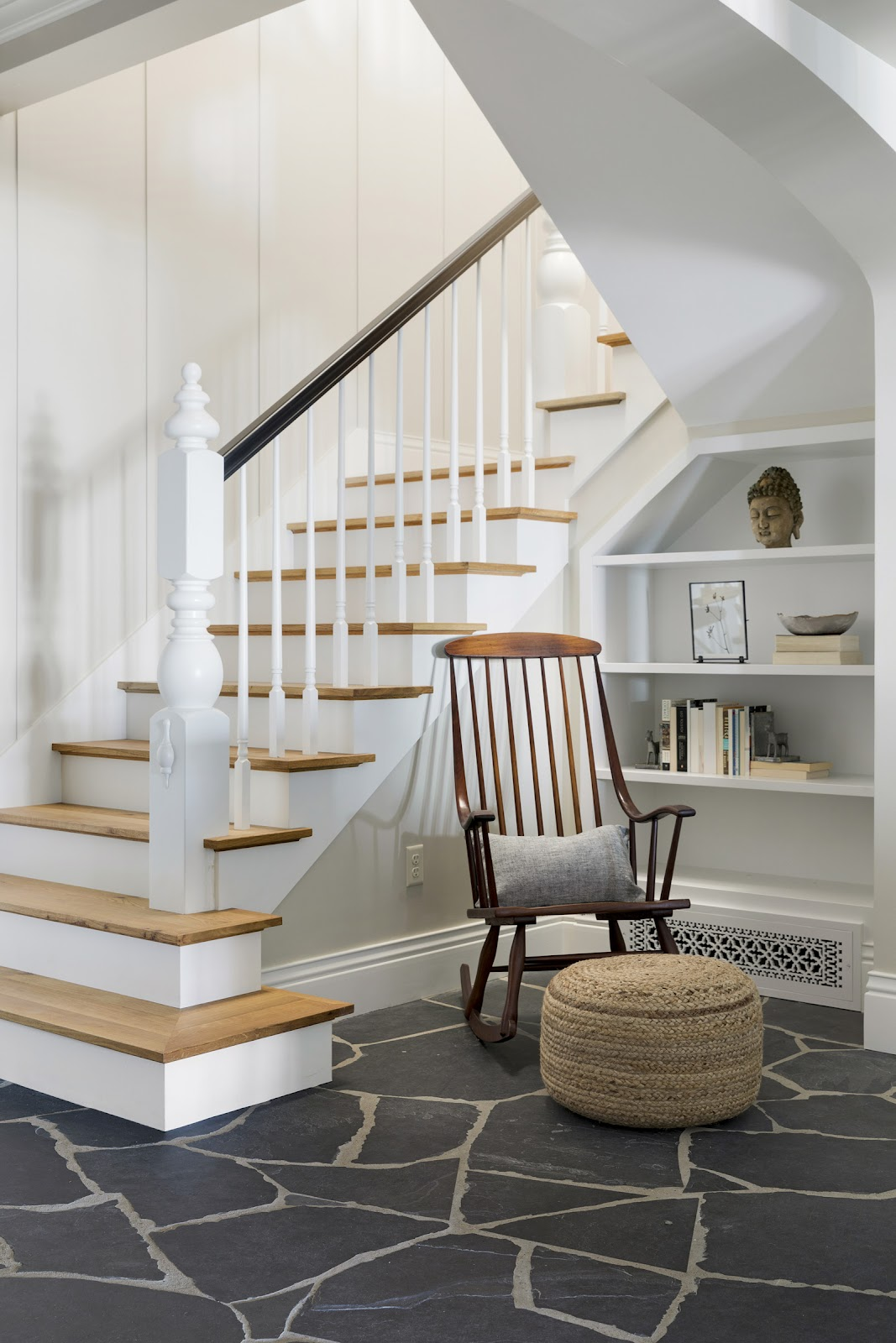 White stairwell with an antique eco-friendly wooden rocking chair.