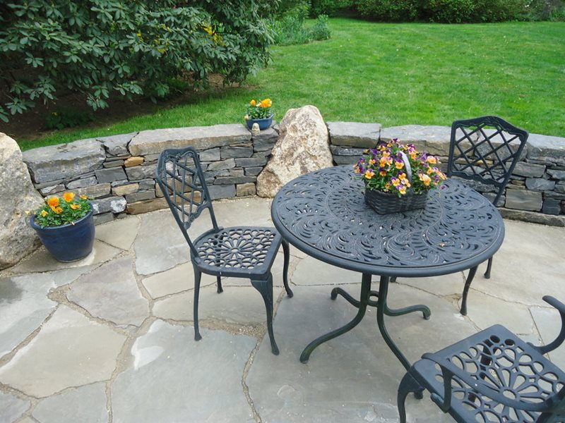 black metal table on stone patio