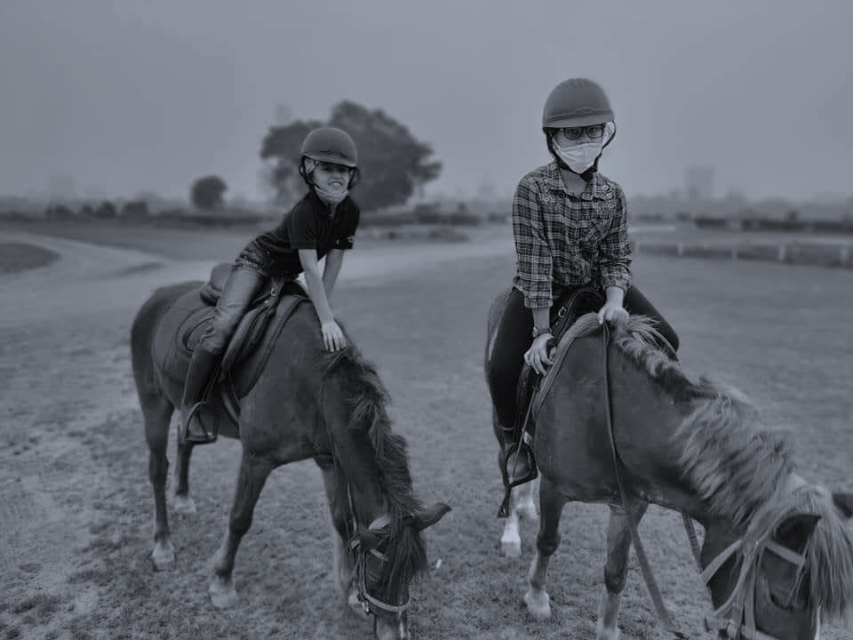 A couple of people riding horsesDescription automatically generated with low confidence