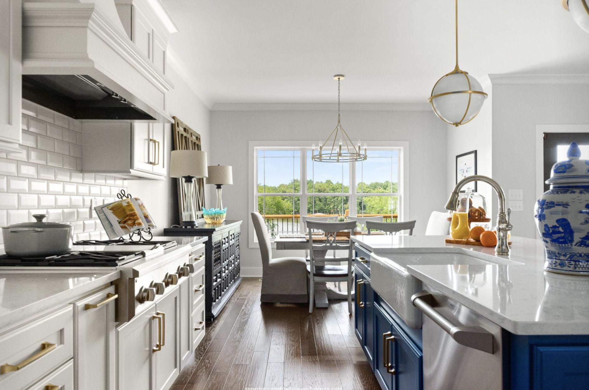 superior-construction-lebanon-tn-common-design-mistakes-kitchen-with-gold-hardware-blue-cabinet-island