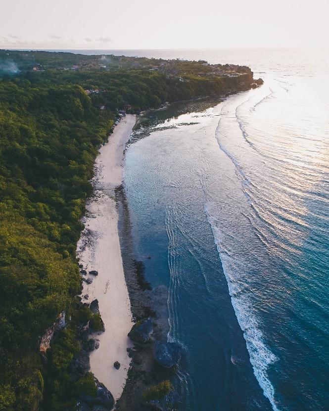 surfing at adang padang beach
