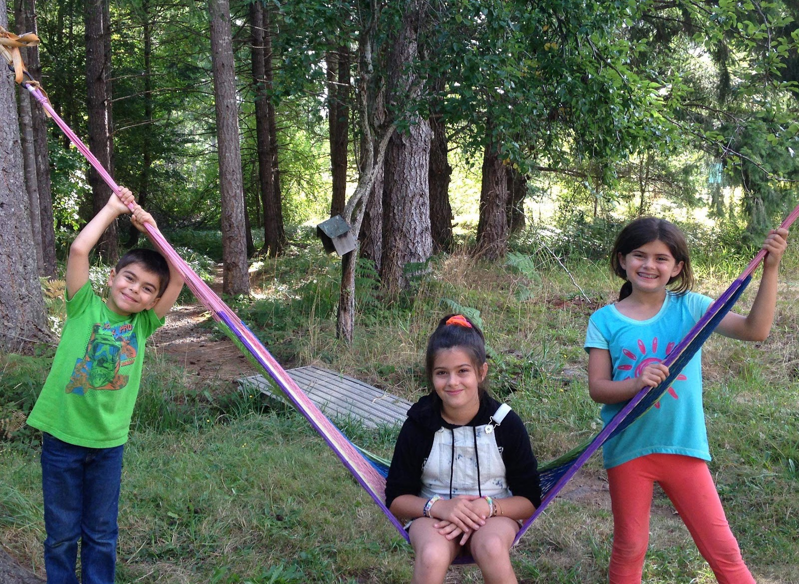 From left to right: Dersim, 7, Sharvahn, 11, Rojevahn, 9, relax in British Columbia.