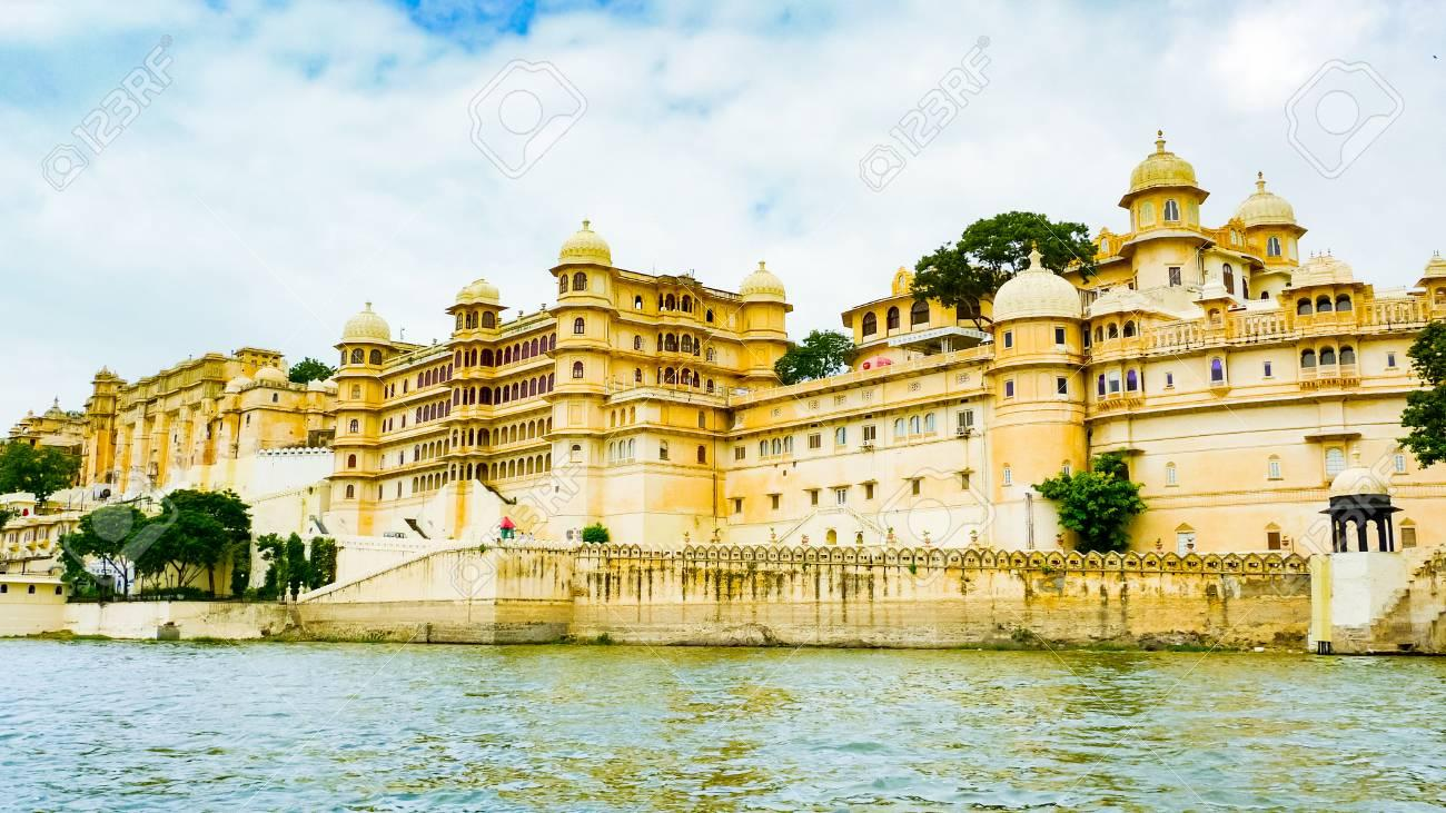 116658746-city-palace-complex-seen-from-lake-pichola-udaipur-rajasthan-india.jpg