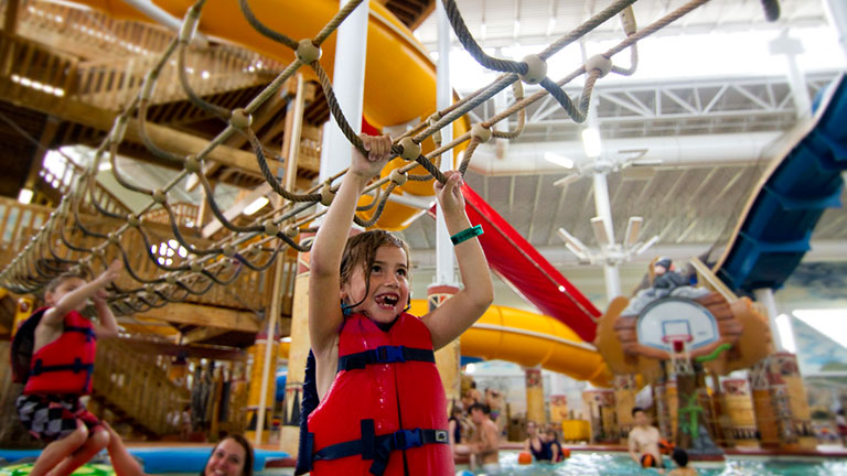 children climbing ropes in waterpark