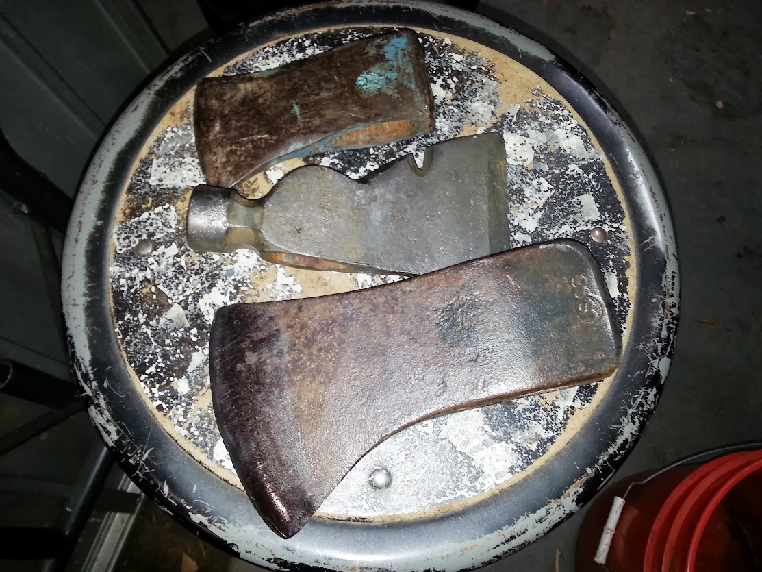Three axe heads ready for restoration