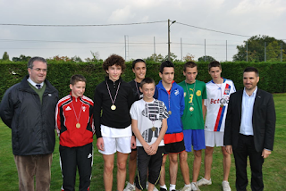 """(Left: With my counterpart as head of local Catholic secondary """"Collège"""", and prize-winning runners from both schools.)"""