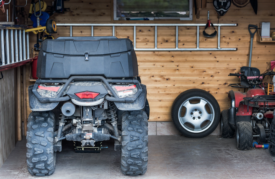 atv and tools inside garage