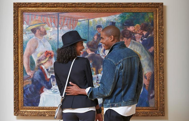 Couple standing in front of a painting