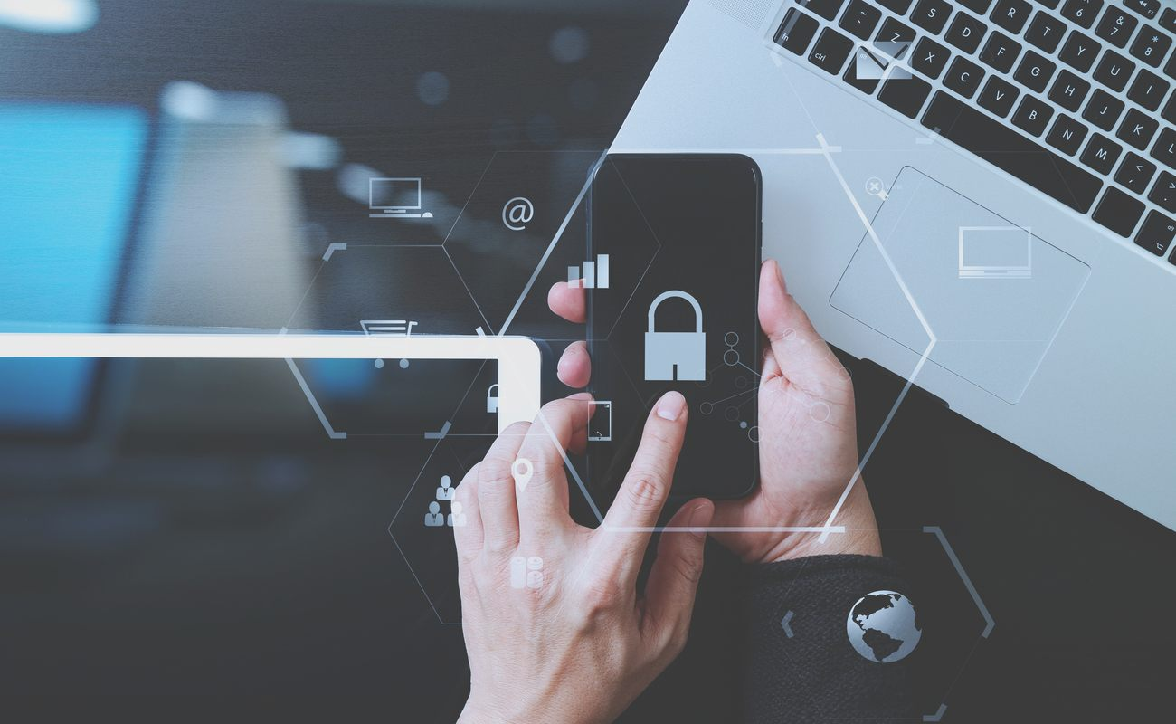 Businessman hand working with VR screen padlock icon