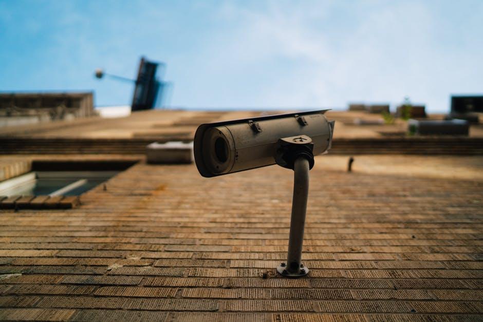 Surveillance Camera Installed in Brick Wall