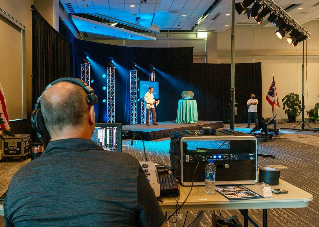 A rehearsal on set for a virtual event production.