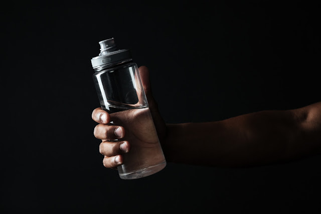 water bottle in hand during exercise