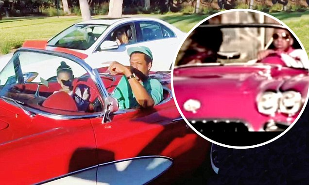 Jay-Z and Blue Ivy in red and white 1957 C1 Corvette
