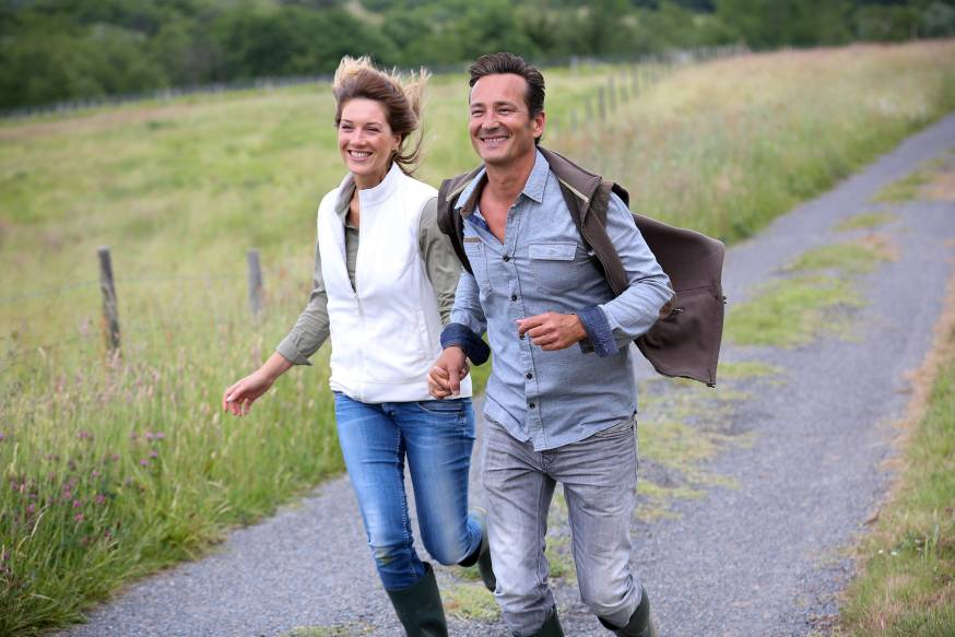 web-happy-middle-aged-couple-running-goodluz-shutterstock_196238294