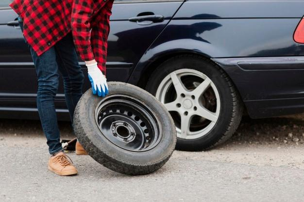Medium shot of man with spare tire