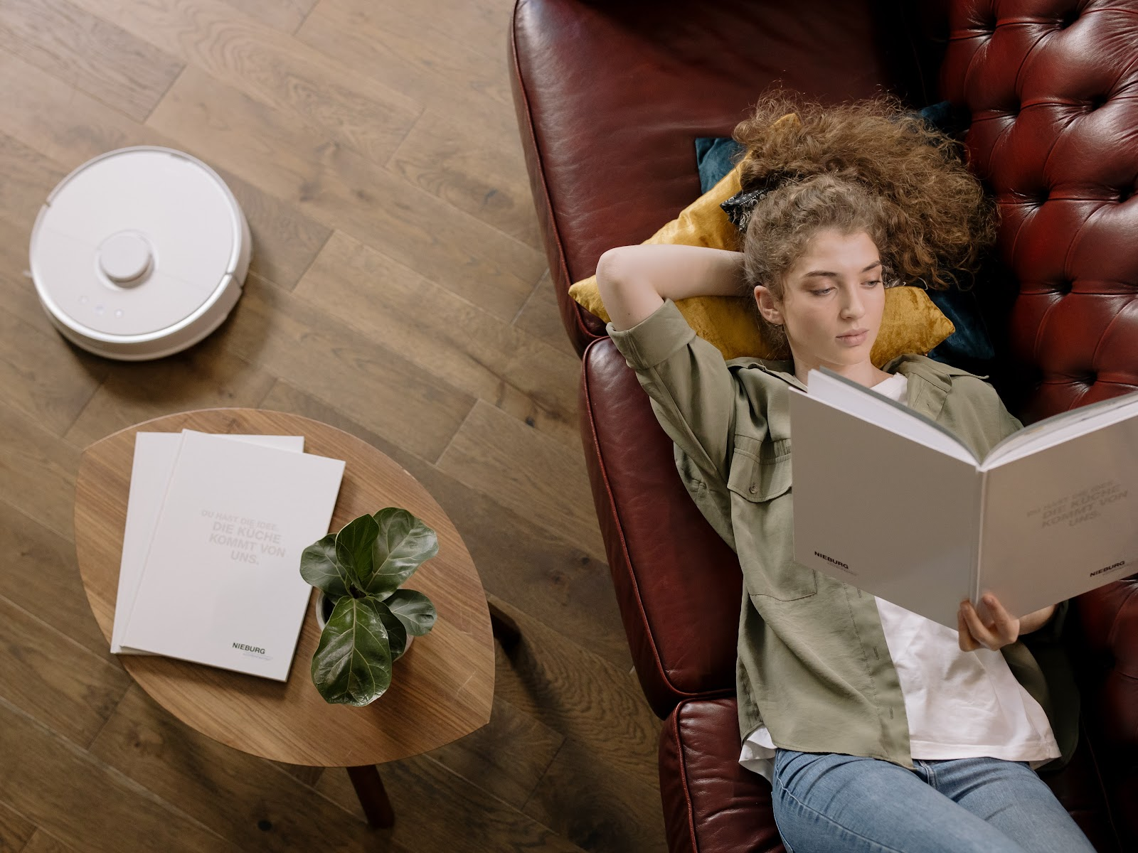 girl laying down in sofa next to a coffee table