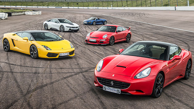 Selection of supercars parked on a racing track