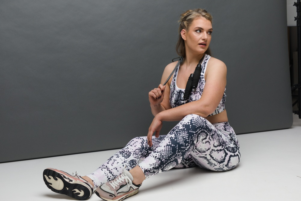 woman in a leggings and sports bra set
