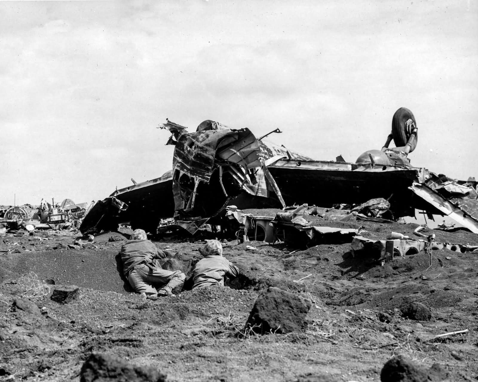 Wrecked_Japanese_aircraft_and_Marines_on_Motoyama_airfield_Iwo_Jima.jpg