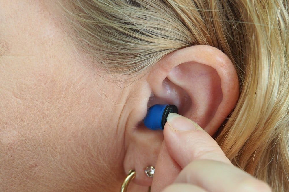 woman wearing blue stud earring