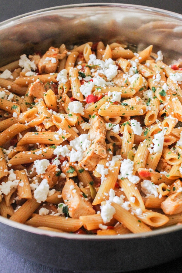 Loaded with tender chicken, lots of veggies, and a flavorful sauce, this one pan Chicken Fajita Pasta is incredibly delicious and super simple to make!