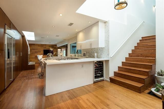 dallas 70s home before renovations property listing dated staircase kitchen