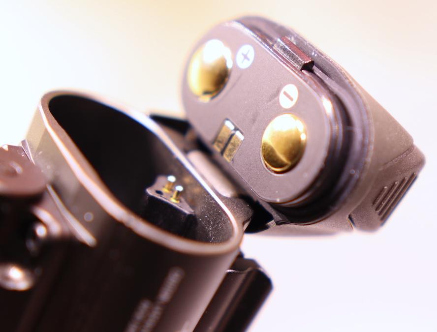 The Olight Baldr Pro's battery case open.