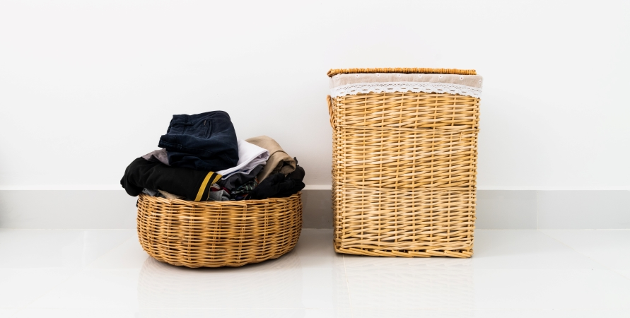 Keep your closet organized by adding a trash can and donation bin to the space.