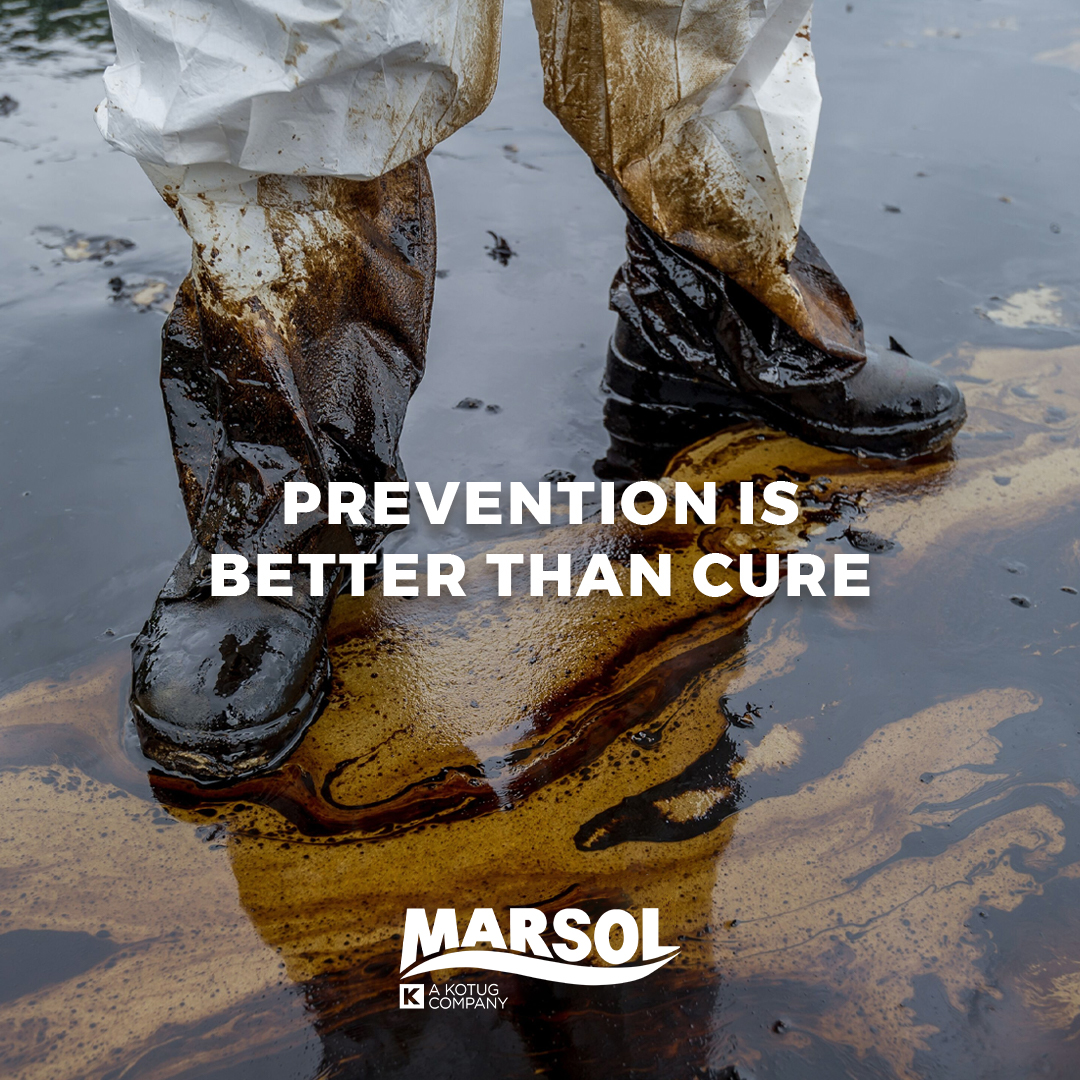 Man standing in oil. Prevent oil spills with sustainable integrity management for your offshore terminal.