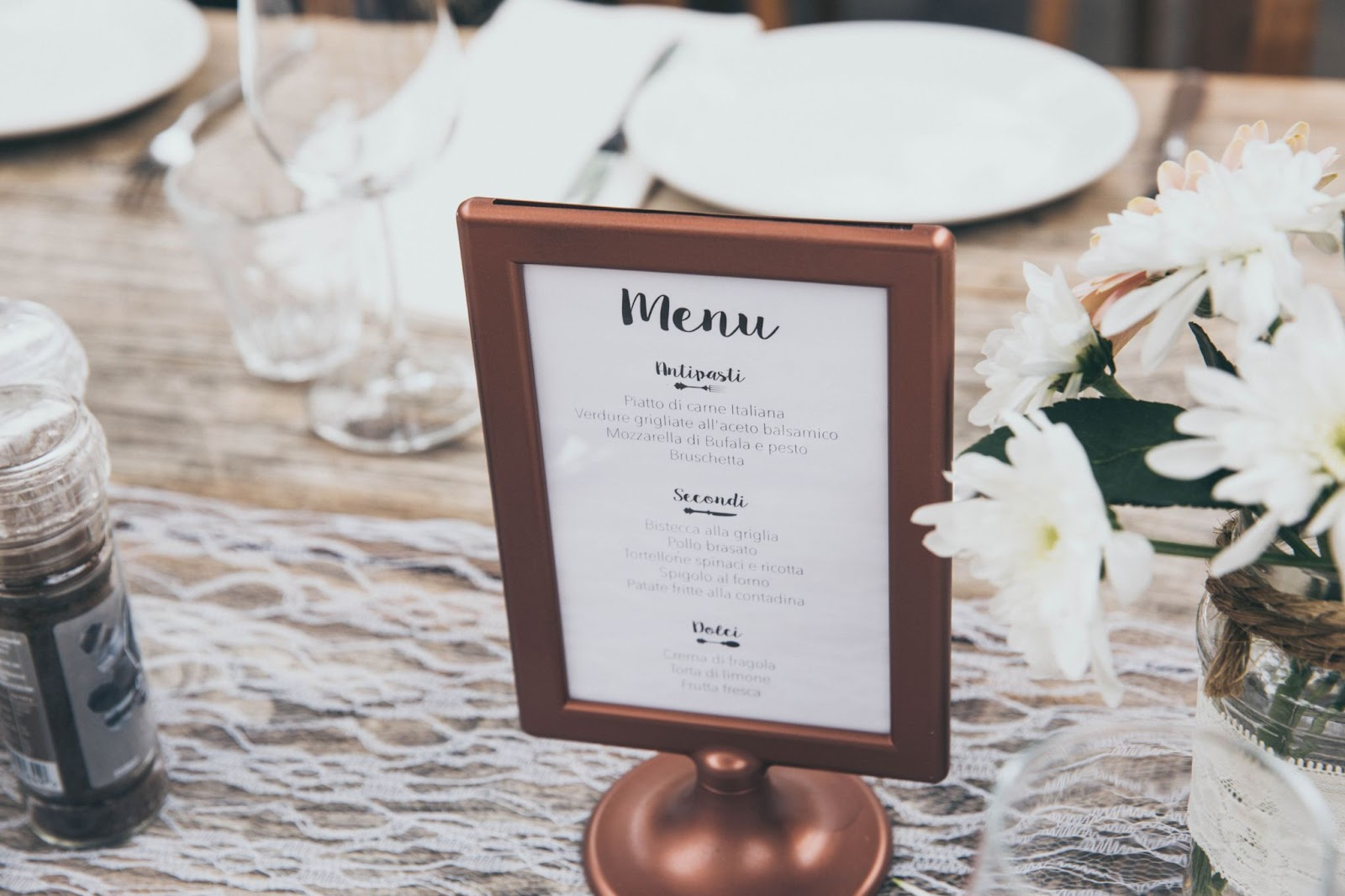 Catered menu in a stand on a decorated table