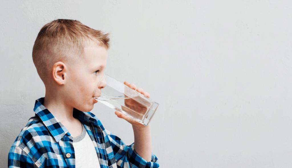 little boy drinking fluoride free water, fluoride detox