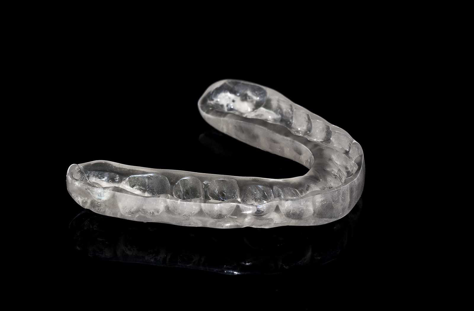 occlusal splint for nightwear on black background