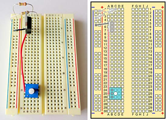 A breadboard with wires, transistor, and potentiometer.