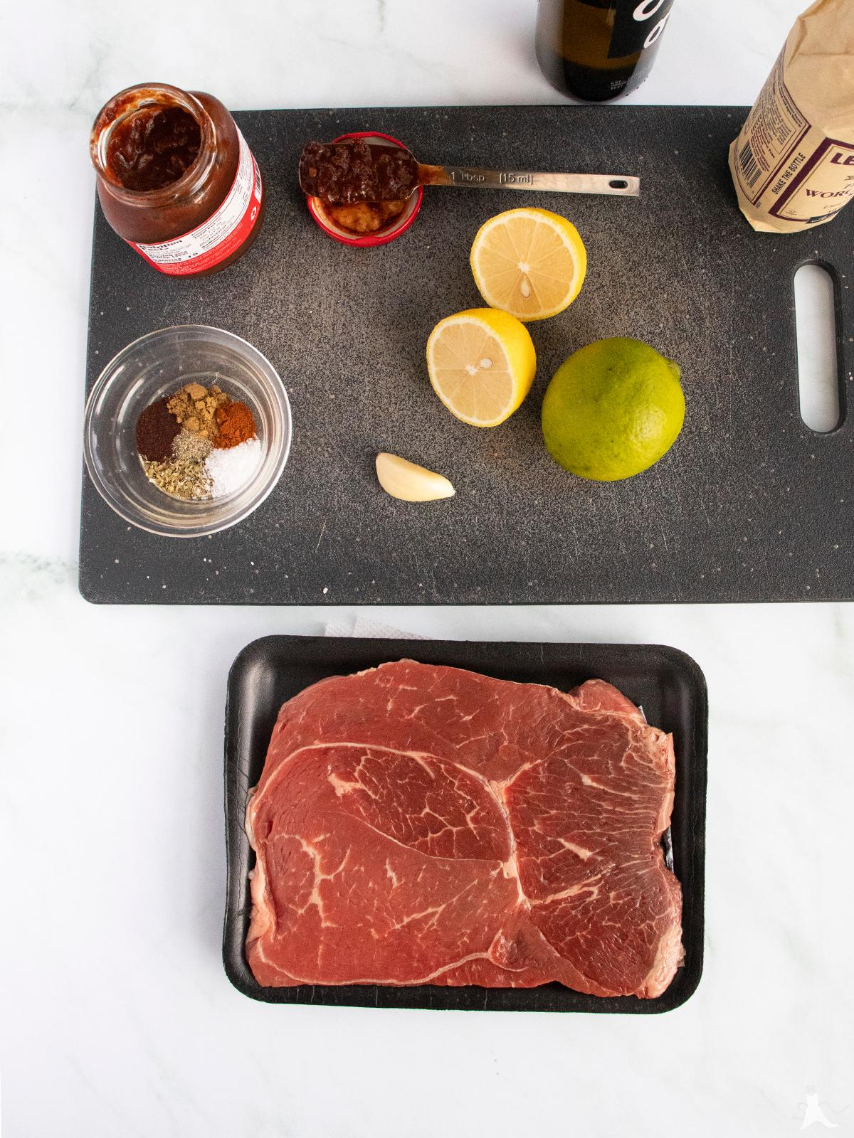 Raw Sirloin Tip Steak with ingredients for chipotle marinade
