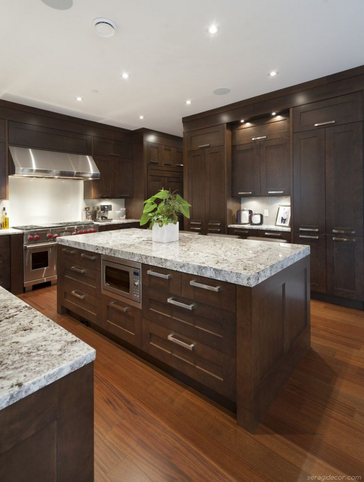 large contemporary kitchen with brown shaker cabinets, granite countertops and chrome cabinet pulls