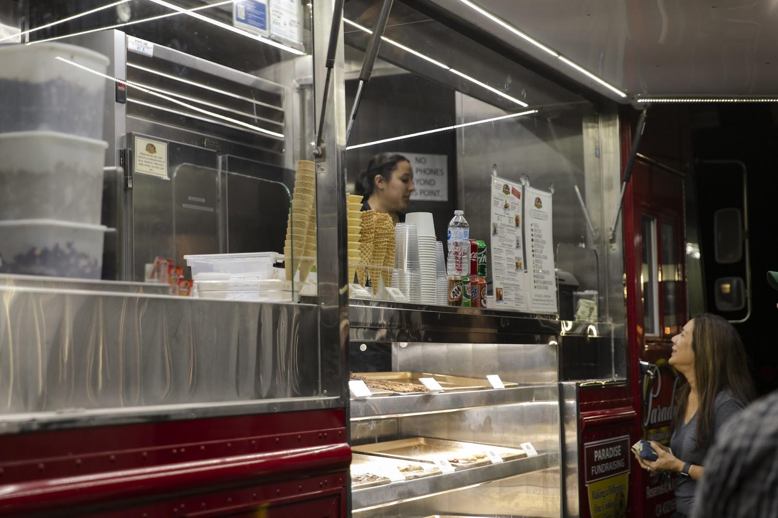 Woman ordering from Paradise Truck