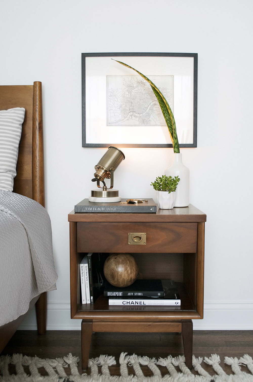 Hang An Artwork Above Nightstand with A Spotlight