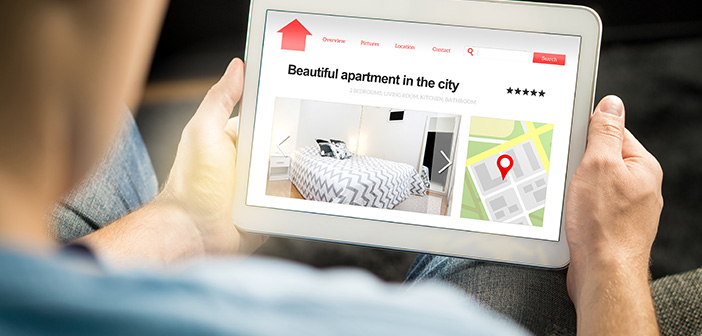 Man Search Apartments And Houses Online With Mobile Device. Holiday Home Rental Or Real Estate Website Or Application. Imaginary Internet Marketplace For Vacation Lodging Or Finding New Home.