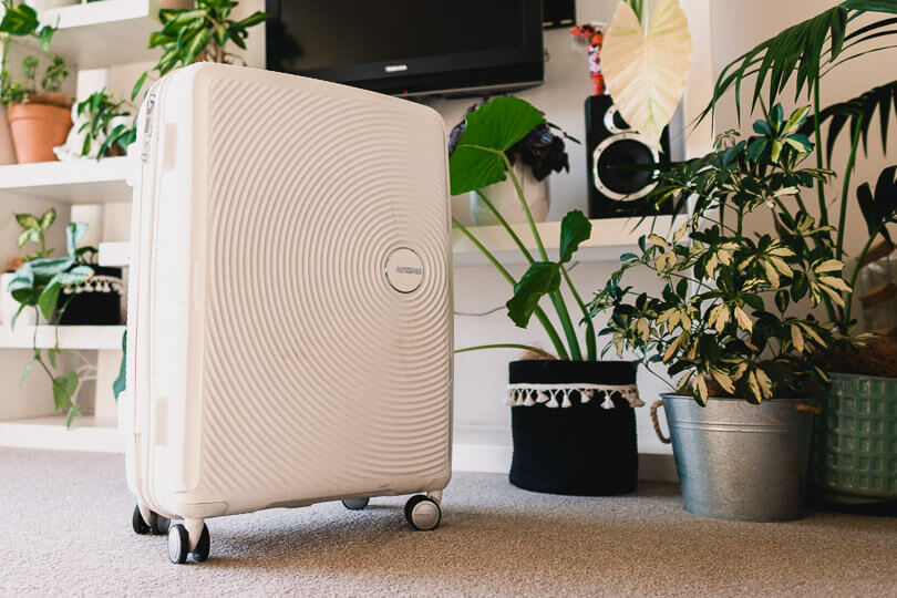 Packed White American Tourister Luggage