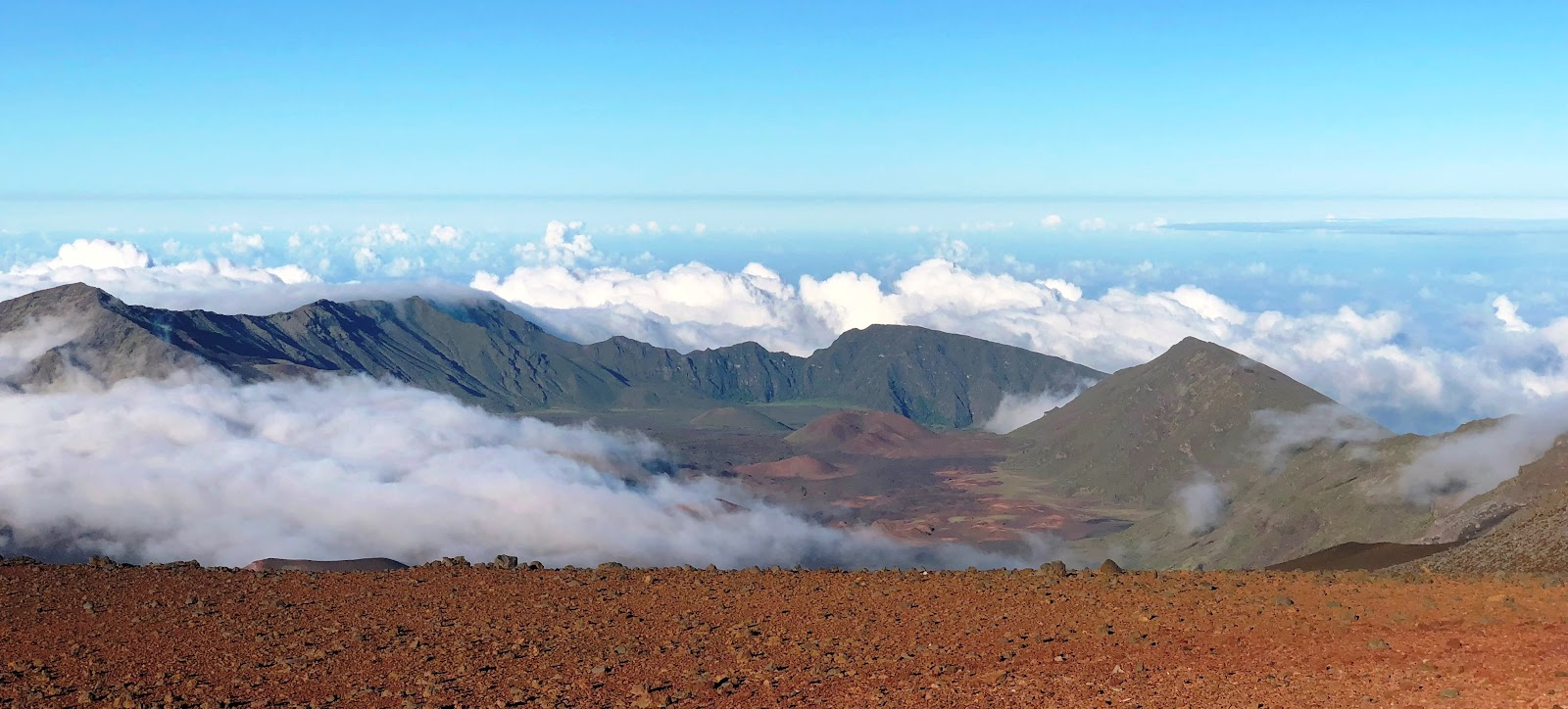 Cycling Haleakala Volcano - crater, clouds and blue sky