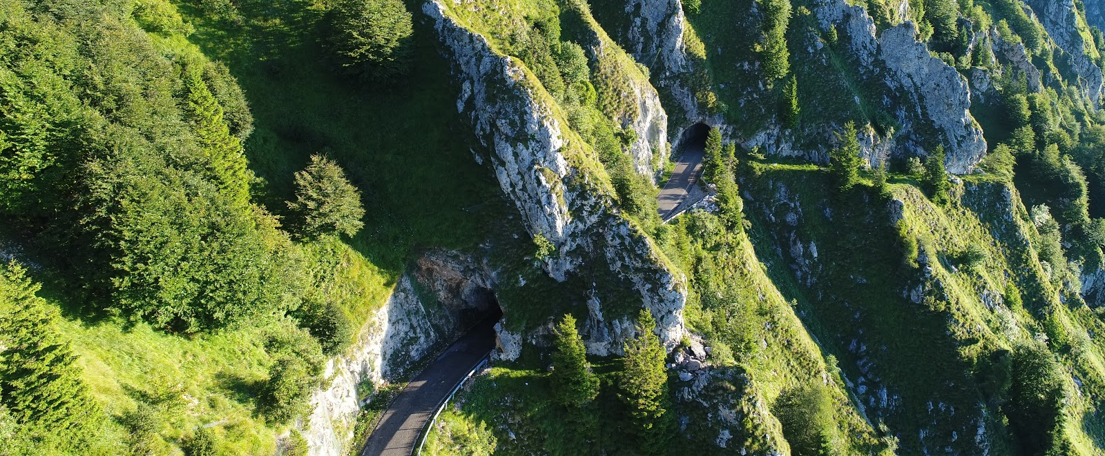 Bicycle ride Monte Grappa from Possagno - aerial drone photo of tunnels and cliff