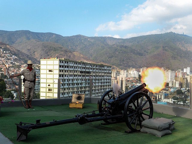 A soldier of the Bolivarian militia shoots a cannon during a ceremony for the third anniversary of late Venezuelan President Hugo Chavez's death at the Cuartel de la Montana barracks in Caracas on March 5, 2016. AFP PHOTO/FEDERICO PARRA / AFP / FEDERICO PARRA (Photo credit should read FEDERICO PARRA/AFP/Getty Images)