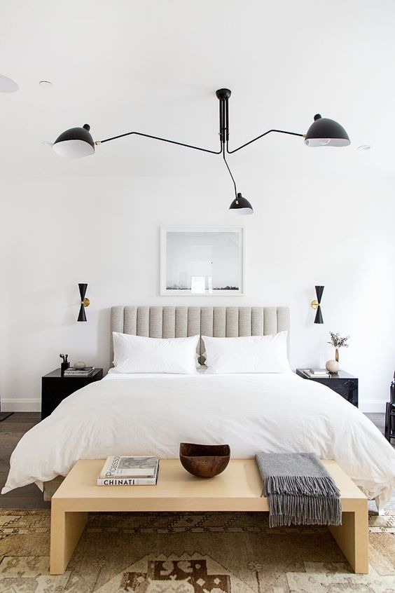 A Wooden Simple Seating Area at the Foot of Your Bed