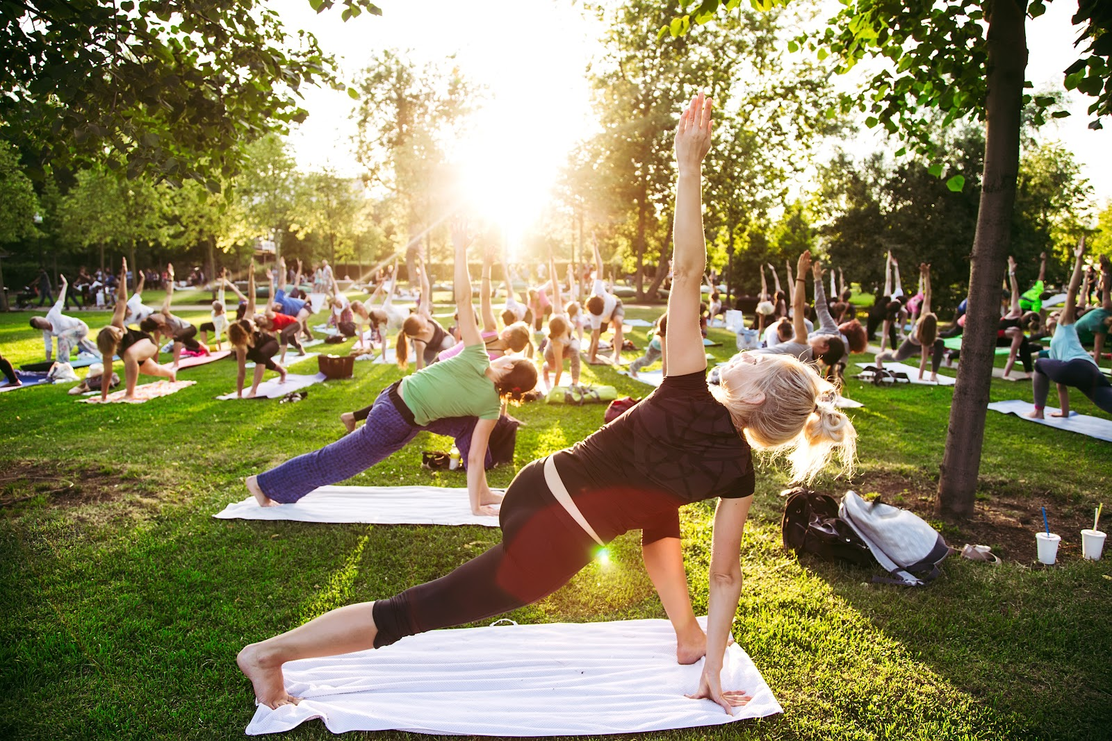 People outside in nature doing yoga, dealing with PTSD in a healthy way
