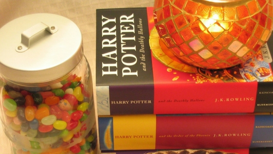 jar of candy next to a stack of Harry Potter books
