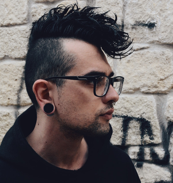 man with stretched lobes and plugs