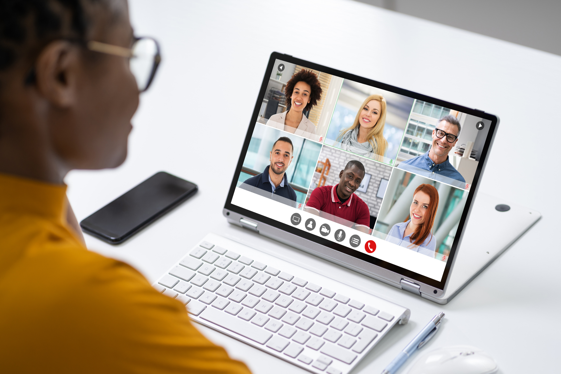 A person having a virtual meeting with colleagues as part of the employee onboarding process.