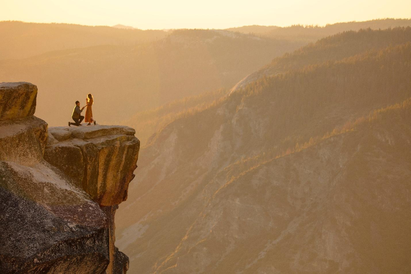 Man proposing on a cliff