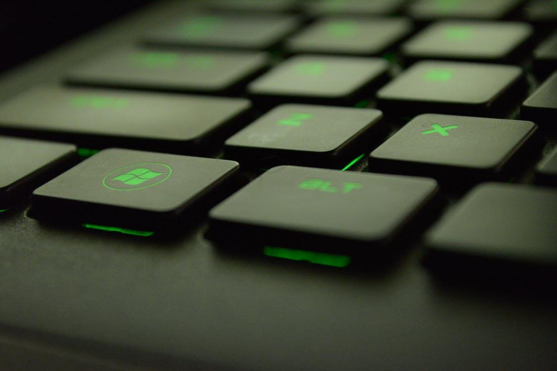 Close-up Photography of Black and Green Computer Keyboard Keys