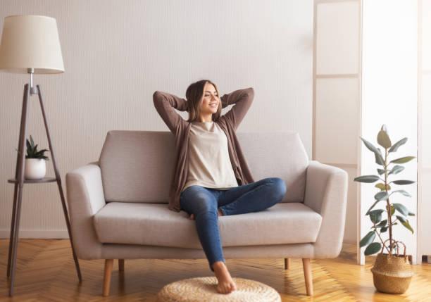 woman seating on sofa chair
